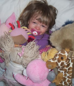 Caption Day, SatCap, surrounded by toys, teddies, soft toys